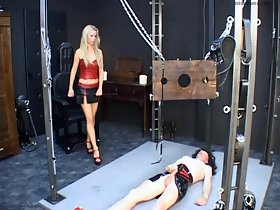 Latex Mistress whips plighted rubber mouse consequent close by dungeon
